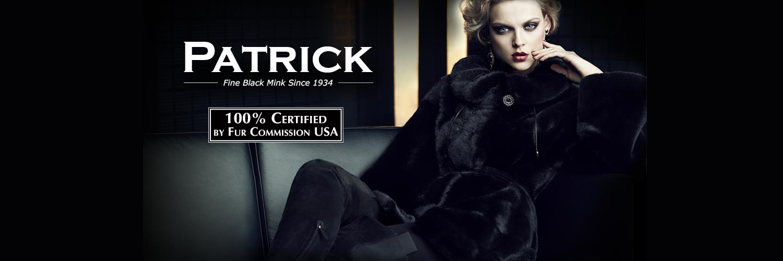 model-wearing-black-mink-coat-on-couch